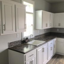 white kitchen with tile backsplash