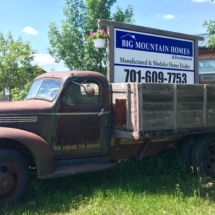 vintage truck with big mountain homes sign
